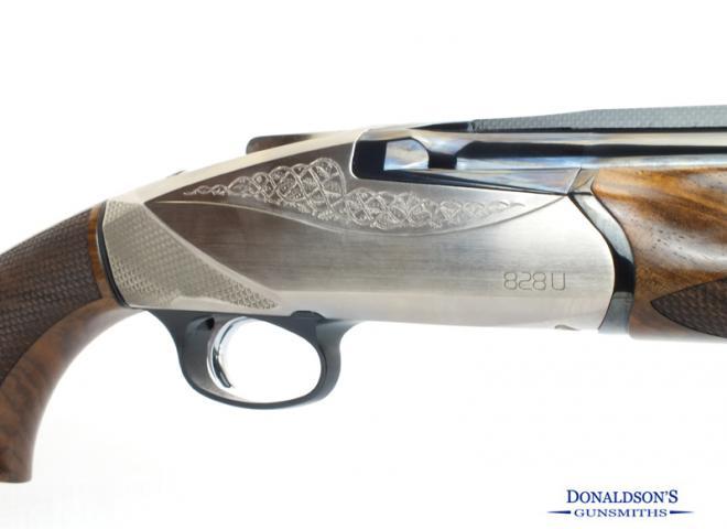 Benelli 12 gauge 828U Silver